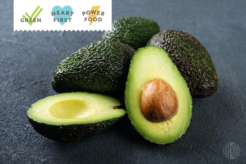 Fresh avocado on dark background. Vegetarian food concept.