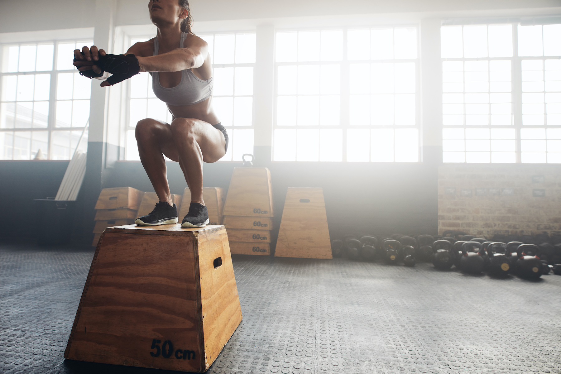 Woman doing box jumps - a form of hiit for ketosis