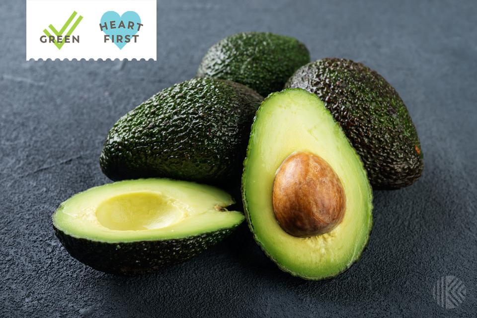Fresh avocado on dark background.