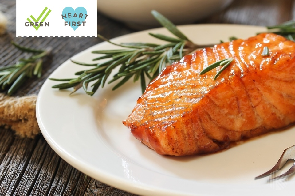 an fried salmon with Rosemary garnish